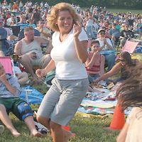 PHOTO: courtesty of www.registercitizen.com - Concert goer Denise Mancini dances in delight during the Harwinton CT Lions Club Concert for Sight. Photo property of the Register Citizen. For permission, write to litchfield@registercitizen.com, attention Jenna C. Thank you!